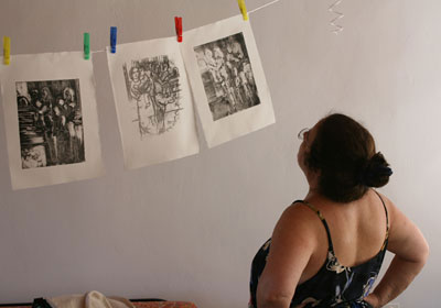 Priscilla viewing her work in the studio.