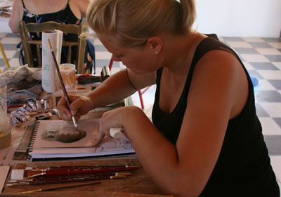 Larisa working on a print in the studio